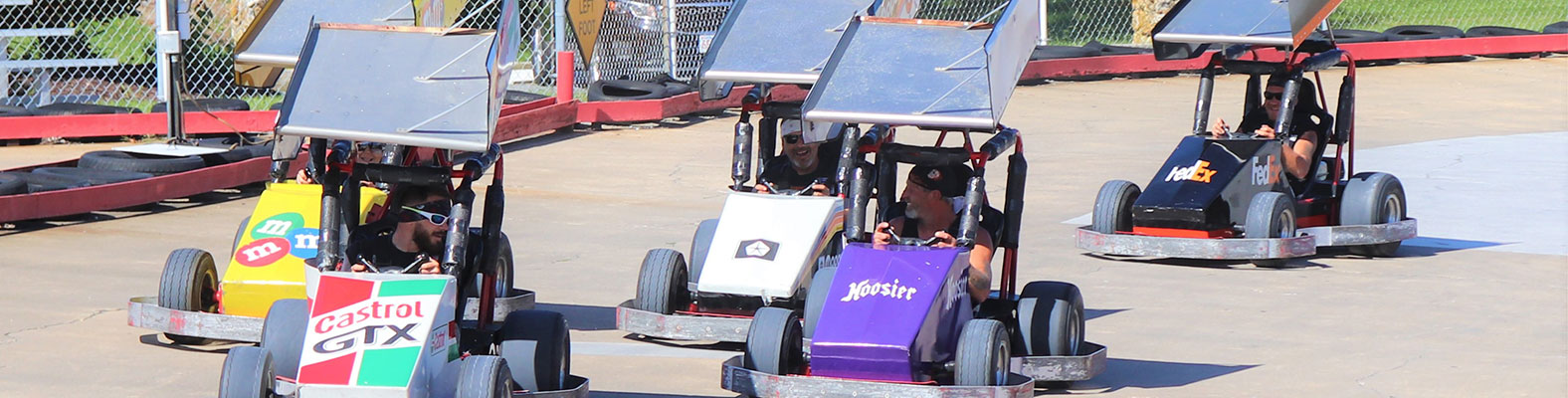 Adults racing in go-karts