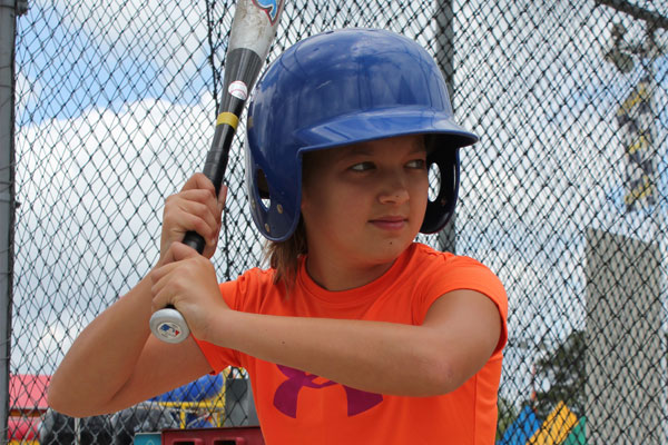 child about to swing in a batting cage